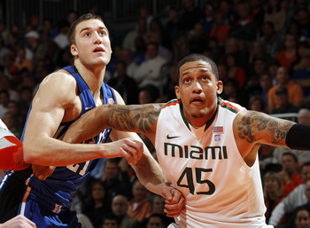 CORAL GABLES, FL - FEBRUARY 13: Julian Gamble #45 of the Miami Hurricanes fights for position with Miles Plumlee #21 of the Duke Blue Devils during a free throw on February 13, 2011 at the BankUnited Center in Coral Gables, Florida. The Blue Devils defeat