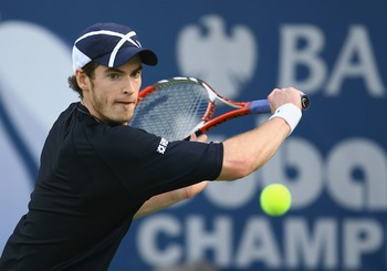 DUBAI, UNITED ARAB EMIRATES - MARCH 06:  Andy Murray of Great Britain plays a backhand against Nikolay Davydenko of Russia during the ATP Barclays Dubai Tennis Championships at the Dubai Tennis Stadium on March 6, 2008 in Dubai, United Arab Emirates.  (Ph