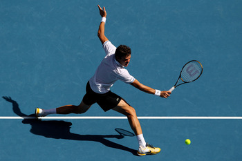 MELBOURNE, AUSTRALIA - JANUARY 24:  Milos Raonic of Canada plays a backhand in his fourth round match against David Ferrer of Spain during day eight of the 2011 Australian Open at Melbourne Park on January 24, 2011 in Melbourne, Australia.  (Photo by Came