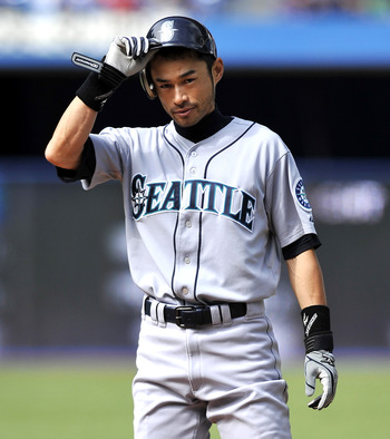 TORONTO - SEPTEMBER 23:   Ichiro Suzuki #51 of the Seattle Mariners tips his hat to the crowd after hitting his 200th hit during the game against the Toronto Blue Jays on September 23, 2010 at Rogers Centre in Toronto, Ontario, Canada. The Blue Jays defea