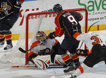 SUNRISE, FL - FEBRUARY 16: Goaltender Sergei Bobrovsky #35 of the Philadelphia Flyers stops a late third period attempt by Stephen Weiss #9 of the Florida Panthers on February 16, 2011 at the BankAtlantic Center in Sunrise, Florida. The Flyers defeated th