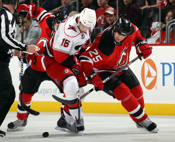 NEWARK, NJ - FEBRUARY 16: Brandon Sutter #16 of the Carolina Hurricanes and Jason Arnott #25 of the New Jersey Devils battle for the puck at the Prudential Center on February 16, 2011 in Newark, New Jersey.  (Photo by Bruce Bennett/Getty Images)
