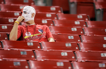 ST. LOUIS - OCTOBER 19:  A lone fan of the St. Louis Cardinals sits dejected following the Cardinals 5-1 loss to the Houston Astros in Game Six of the National League Championship Series October 19, 2005 at Busch Stadium in St. Louis, Missouri. The Astros