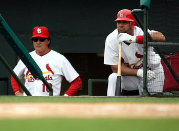 JUPITER, FL - MARCH 29:  Manager Tony La Russa #10 and Albert Pujols #5 of the St. Louis Cardinals stand in the duggout during a game against the Minnesota Twins at Roger Dean Stadium on March 29, 2010 in Jupiter, Florida.  (Photo by Marc Serota/Getty Ima