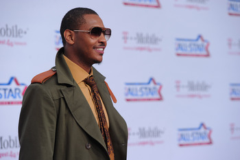 LOS ANGELES, CA - FEBRUARY 20:  NBA player Carmelo Anthony arrives to the T-Mobile Magenta Carpet at the 2011 NBA All-Star Game on February 20, 2011 in Los Angeles, California.  (Photo by Alberto E. Rodriguez/Getty Images)