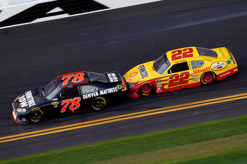 DAYTONA BEACH, FL - FEBRUARY 20:  Regan Smith, driver of the #78 Furniture Row Racing Chevrolet,  and Kurt Busch, driver of the #22 Shell Pennzoil Dodge, race during the NASCAR Sprint Cup Series Daytona 500 at Daytona International Speedway on February 20