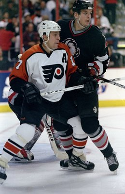 22 Apr 1998:  Left wing Rod Brind''Amour of the Philadelphia Flyers and defenseman Mike Wilson of the Buffalo Sabres in action during a game at the Corestates Center in Philadelphia, Pennsylvania. The Sabres defeated the Flyers 3-2. Mandatory Credit: Crai