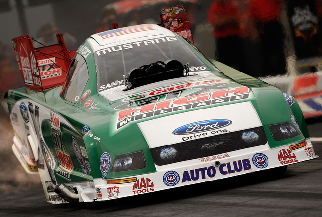 CONCORD, NC - SEPTEMBER 20:  John Force, driver of the Castrol High Mileage Ford funny car drives during the NHRA Carolinas Nationals on September 20, 2009 at Zmax Dragway in Concord, North Carolina.  (Photo by Rusty Jarrett/Getty Images)