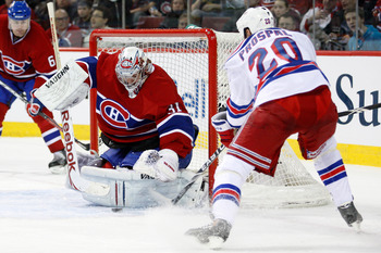 MONTREAL, CANADA - FEBRUARY 5:  Carey Price #31 of the Montreal Canadiens stops the puck on an attempt by Vaclav Prospal #20 of the New York Rangers during the NHL game at the Bell Centre on February 5, 2011 in Montreal, Quebec, Canada.  The Canadiens def
