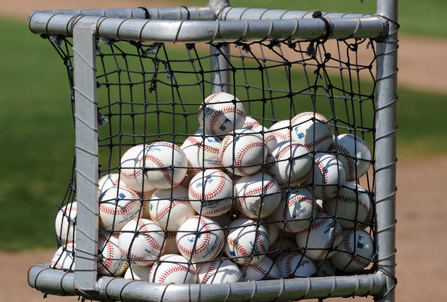 CLEARWATER, FL - FEBRUARY 19:  A cart filled with baseballs is set up for the Philadelphia Phillies during a spring training workout February 19, 2011 the Carpenter Complex at Bright House Field in Clearwater, Florida. (Photo by Al Messerschmidt/Getty Ima