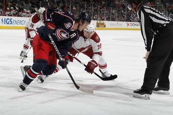 COLUMBUS, OH - JANUARY 11: Ethan Moreau #19 of the Columbus Blue Jackets skates against Lauri Korpikoski #28 of the Phoenix Coyotes during a game on January 11, 2011 at the Nationwide Arena in Columbus, Ohio. (Photo by Gregory Shamus/Getty Images)