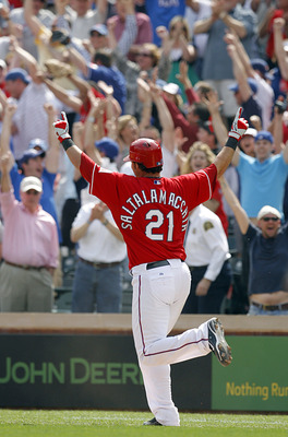 ARLINGTON, TX - APRIL 05:  Catcher Jarrod Saltalamacchia #21 of the Texas Rangers celebrates a walkoff RBI against the Toronto Blue Jays in the bottom of the ninth inning on Opening Day at Rangers Ballpark on April 5, 2010 in Arlington, Texas.  The Ranger