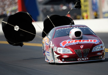 CONCORD, NC - SEPTEMBER 18:   Greg Anderson drives The Summit Racing Equipment GXP  during qualifying for the 2010 O'Reilly Parts NHRA Nationals at zMax Dragway on September 18, 2010 in Concord, North Carolina.  (Photo by Rusty Jarrett/Getty Images)