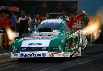 CONCORD, NC - SEPTEMBER 18:  John Force, driver of the Castrol GTX High Mileage Ford drives during second round qualifying for the NHRA Carolinas Nationals on September 18, 2009 at Zmax Dragway in Concord, North Carolina.  (Photo by Rusty Jarrett/Getty Im