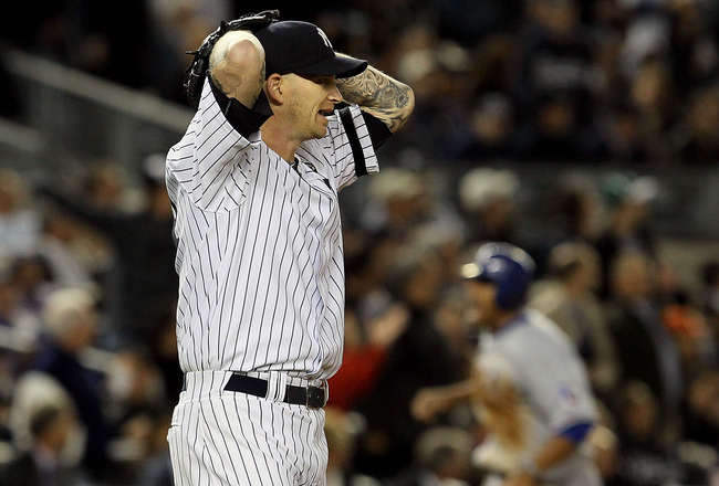 NEW YORK - OCTOBER 19:  A.J. Burnett #34 of the New York Yankees reacts after giving up a three-run home run to Bengie Molina #11 of the Texas Rangers in the top of the sixth inning in Game Four of the ALCS during the 2010 MLB Playoffs at Yankee Stadium o