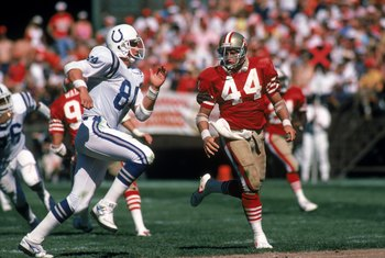 SAN FRANCISCO - OCTOBER 5:  Full back Tom Rathman #44 of the San Francisco 49ers looks to make a block against Indianapolis Colts tight end Mark Boyer #84 during a game at Candlestick Park on October 5, 1986 in San Francisco, California.  The 49ers won 35