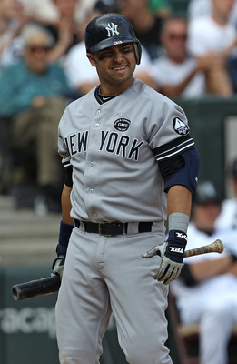 CHICAGO - AUGUST 29: Nick Swisher #33 of the New York Yankees reacts after striking out against Gavin Floyd of the Chicago White Sox at U.S. Cellular Field on August 29, 2010 in Chicago, Illinois. The Yankees defeated the White Sox 2-1. (Photo by Jonathan