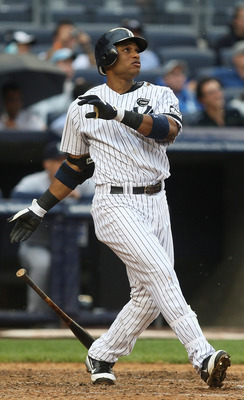 NEW YORK - AUGUST 22:  Robinson Cano #24 of the New York Yankees watches his grand slam home run against the Seattle Mariners during the fifth inning on August 22, 2010 at Yankee Stadium in the Bronx borough of New York City.  (Photo by Andrew Burton/Gett
