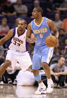 PHOENIX - OCTOBER 22:  Arron Afflalo #6 of the Denver Nuggets handles the ball during the preseason NBA game against the Phoenix Suns at US Airways Center on October 22, 2010 in Phoenix, Arizona. NOTE TO USER: User expressly acknowledges and agrees that,
