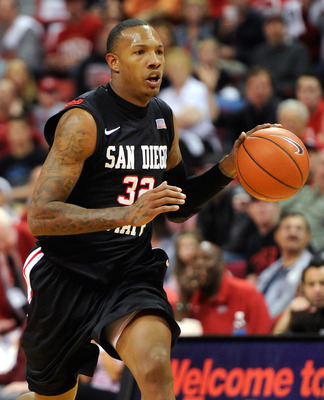 LAS VEGAS, NV - FEBRUARY 12:  Billy White #32 of the San Diego State Aztecs brings the ball up the court during a game against the UNLV Rebels at the Thomas & Mack Center February 12, 2011 in Las Vegas, Nevada. San Diego State won 63-57.  (Photo by Ethan