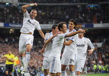 MADRID, SPAIN - NOVEMBER 07: Ricardo Carvalho (C) of Real Madrid celebrates with Pepe (L) and Sami Khedira (#24) after scoring his team's first goal during the La Liga match between Real Madrid and Atletico Madrid at Estadio Santiago Bernabeu on November