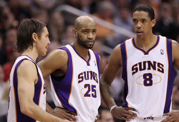 PHOENIX, AZ - FEBRUARY 17:  (L-R) Steve Nash #13, Vince Carter #25 and Channing Frye #8 of the Phoenix Suns react during a break from the NBA game against the Dallas Mavericks at US Airways Center on February 17, 2011 in Phoenix, Arizona.  The Mavericks d
