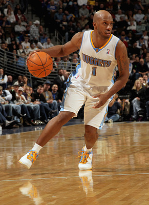 DENVER, CO - FEBRUARY 10:  Chauncey Billups #1 of the Denver Nuggets dribbles the ball against the Dallas Mavericks during NBA action at the Pepsi Center on February 10, 2011 in Denver, Colorado. The Nuggets defeated the Mavericks 121-120. NOTE TO USER: U