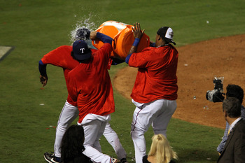 ARLINGTON, TX - OCTOBER 22:  Manager Ron Washington of the Texas Rangers has a gatorade cooler dumped on him after the Rangers defeated the New York Yankees in Game Six of the ALCS to advance to the World Series during the 2010 MLB Playoffs at Rangers Bal