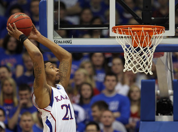 LAWRENCE, KS - FEBRUARY 12:  Markieff Morris #21 of the Kansas Jayhawks dunks during the game against the Iowa State Cyclones on February 12, 2011 at Allen Fieldhouse in Lawrence, Kansas.  (Photo by Jamie Squire/Getty Images)