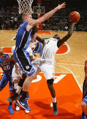 CORAL GABLES, FL - FEBRUARY 13: Mason Plumlee #5 of the Duke Blue Devils goes up to block the shot by Durand Scott #1 of the Miami Hurricanes on February 13, 2011 at the BankUnited Center in Coral Gables, Florida. The Blue Devils defeated the Hurricanes 8