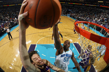 NEW ORLEANS, LA - DECEMBER 29:  Pau Gasol #16 of the Los Angeles Lakers shoots the ball over Emeka Okafor #50 of the New Orleans Hornets at the New Orleans Arena on December 29, 2010 in New Orleans, Louisiana.   The Lakers defeated the Hornets 103-88.  NO