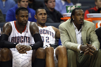 CHARLOTTE, NC - DECEMBER 21:  Teammates Stephen Jackson #1, Boris Diaw #32 and Gerald Wallace #3 of the Charlotte Bobcats sit on the bench during their 99-81 loss to the Oklahoma City Thunder at Time Warner Cable Arena on December 21, 2010 in Charlotte, N