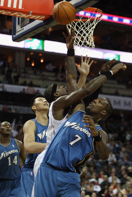 CHARLOTTE, NC - JANUARY 08:  Andray Blatche #7 of the Washington Wizards collides with Stephen Jackson #1 of the Charlotte Bobcats during their game at Time Warner Cable Arena on January 8, 2011 in Charlotte, North Carolina. NOTE TO USER: User expressly a