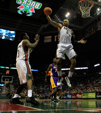 MILWAUKEE - NOVEMBER 16: Drew Gooden #0 of the Milwaukee Bucks grabs a rebound next to teammate Brandon Jennings #3 against the Los Angeles Lakers at the Bradley Center on November 16, 2010 in Milwaukee, Wisconsin. The Lakers defeated the Bucks 118-107. N