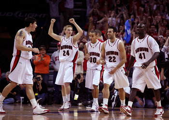 CHARLOTTE, NC - DECEMBER 06:  The Davidson Wildcats react to their 72-67 victory over the North Carolina State Wolfpack after their game at Time Warner Cable Arena on December 6, 2008 in Charlotte, North Carolina.  (Photo by Streeter Lecka/Getty Images)