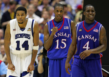 SAN ANTONIO - APRIL 07:  Mario Chalmers #15 of the Kansas Jayhawks reacts in overtime along with teammate Sherron Collins #4 as Chris Douglas-Roberts #14 of the Memphis Tigers looks on during the 2008 NCAA Men's National Championship game at the Alamodome