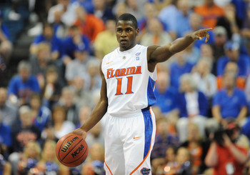 GAINESVILLE, FL - NOVEMBER 16: Guard Erving Walker #11 of the Florida Gators directs play against the Ohio State Buckeyes November 16, 2010 at the Stephen C. O'Connell Center in Gainesville, Florida.  (Photo by Al Messerschmidt/Getty Images)