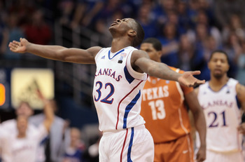 LAWRENCE, KS - JANUARY 22:  Josh Selby #32 of the Kansas Jayhawks reacts after scoring during the game against the Texas Longhorns on January 22, 2011 at Allen Fieldhouse in Lawrence, Kansas.  (Photo by Jamie Squire/Getty Images)