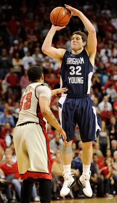 LAS VEGAS, NV - JANUARY 05:  Jimmer Fredette #32 of the Brigham Young University Cougars shoots over Tre'Von Willis #33 of the UNLV Rebels during their game at the Thomas & Mack Center January 5, 2011 in Las Vegas, Nevada. BYU won 89-77.  (Photo by Ethan