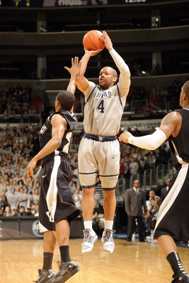 WASHINGTON, DC - FEBRUARY 5:  Chris Wright #4 of the Georgetown Hoyas takes a jump shot during a college basketball against the Providence Friars on February 5, 2011 at the Verizon Center in Washington, DC.  The Hoyas won 83-81.  (Photo by Mitchell Layton