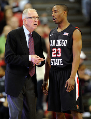 LAS VEGAS, NV - FEBRUARY 12:  Head coach Steve Fisher of the San Diego State Aztecs talks to D.J. Gay #23 during the team's game against the UNLV Rebels at the Thomas & Mack Center February 12, 2011 in Las Vegas, Nevada. San Diego State won 63-57.  (Photo