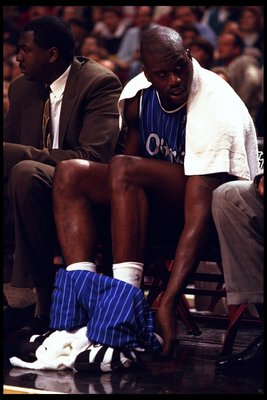 25 Feb 1996: Center Shaquille O'Neal of the Orlando Magic on the bench during a game against the Chicago Bulls played at the United Center in Chicago, Ilinois. The Bulls won the game, 111-91.
