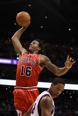 PHOENIX - NOVEMBER 24:  James Johnson #16 of the Chicago Bulls goes up for a slam dunk over Channing Frye #8 of the Phoenix Suns during the NBA game at US Airways Center on November 24, 2010 in Phoenix, Arizona. NOTE TO USER: User expressly acknowledges a