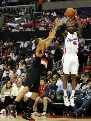 LOS ANGELES, CA - OCTOBER 27:  Rasual Butler #45 of the Los Angeles Clippers shoots a jumper from the corner over Brandon Roy #7 of the Portland Trail Blazers at Staples Center on October 27, 2010 in Los Angeles, California. NOTE TO USER: User expressly a