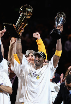 LOS ANGELES, CA - JUNE 17:  Kobe Bryant #24 of the Los Angeles Lakers holds both the Larry O'Brien trophy and the Bill Russell Finals MVP trophy after the Lakers defeated the Boston Celtics 83-79 in Game Seven of the 2010 NBA Finals at Staples Center on J