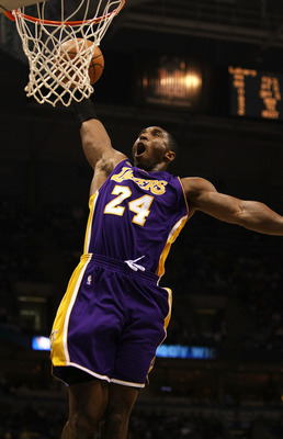 MILWAUKEE - NOVEMBER 21: Kobe Bryant#24 of the Los Angeles Lakers dunks the ball against the Milwaukee Bucks on November 21, 2007 at the Bradley Center in Milwaukee, Wisconsin. NOTE TO USER: User expressly acknowledges and agreees that, by downloading and