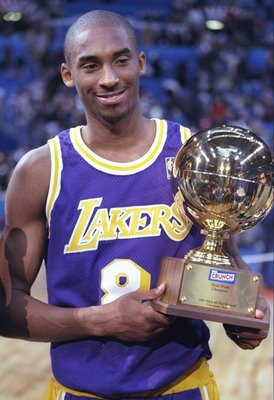 8 Feb 1997:  Guard Kobe Bryant of the Los Angeles Lakers holds the Slam Dunk Contest trophy at the Gund Arena in Cleveland, Ohio. Mandatory Credit: Brian Bahr  /Allsport