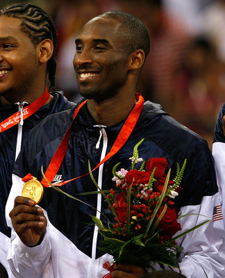 BEIJING - AUGUST 24:  (L-R) Carmelo Anthony, Kobe Bryant and Chris Bosh of the United States hold their gold medals after defeating Spain 118-107 in the gold medal game during Day 16 of the Beijing 2008 Olympic Games at the Beijing Olympic Basketball Gymn