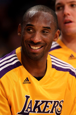 LOS ANGELES, CA - NOVEMBER 05:  Kobe Bryant #24 of the Los Angeles Lakers smiles on the bench in the game with the Toronto Raptors at Staples Center on November 5, 2010 in Los Angeles, California.  The Lakers won 108-102.   NOTE TO USER: User expressly ac