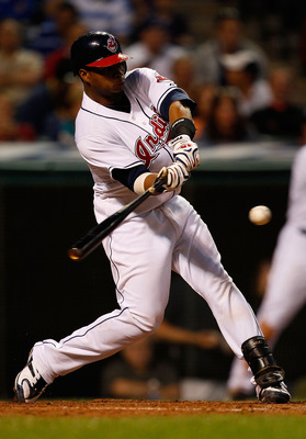CLEVELAND - JUNE 17:  Carlos Santana #41 of the Cleveland Indians hits a triple against the New York Mets during the game on June 17, 2010 at Progressive Field in Cleveland, Ohio. Santana later went on to score.  (Photo by Jared Wickerham/Getty Images)